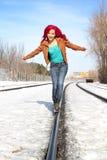 Girl walking on rail Royalty Free Stock Photo