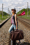 Girl walking on railroad Stock Photos