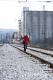 A girl walking on the railroad Royalty Free Stock Photography