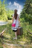 Girl walking on railroad Stock Images