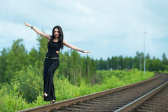 Girl walking on railroad track Royalty Free Stock Photos