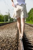 Girl walking on a railway Royalty Free Stock Images