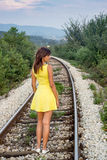 Girl walking on the railway Royalty Free Stock Photography