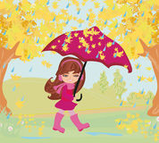 Girl walking in the rain Royalty Free Stock Image