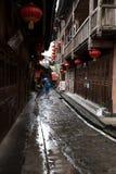 Girl walking in the rain Stock Photos