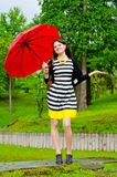 Girl walking after the rain Stock Photography