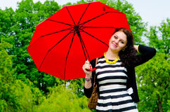 Girl walking after the rain Royalty Free Stock Images