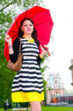Girl walking after the rain Royalty Free Stock Photos