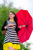 Girl walking after the rain Stock Image