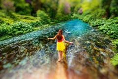 Girl walking on the river Stock Photography