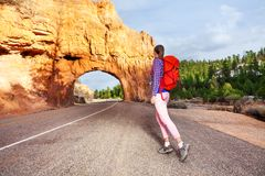 Girl walking on the road with Red canyon view Royalty Free Stock Images