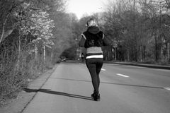 Girl walking on the road Royalty Free Stock Photography