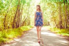 Girl walking among the trees stock photos