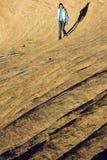 Girl walking Rock Waves Stock Image