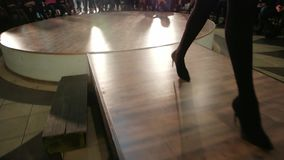 Girl walking runway, womans legs walking down catwalk closeup, professional model defile, fashion stock footage