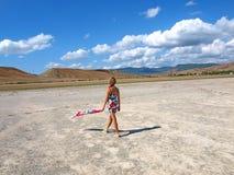 Girl walking on the salt lake Stock Images