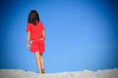 Girl walking in sand Stock Image