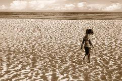 Girl Walking on Sand Stock Photo