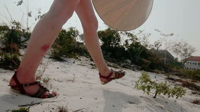 Girl walking on sand. Close-up of legs. Girl in shorts walking on sand. Close-up of legs. Slow motion stock video