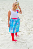 Girl walking on the sandy beach Stock Photos