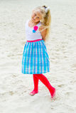 Girl walking on the sandy beach Royalty Free Stock Images