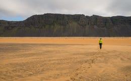 Girl walking on scenic Iceland coastline Royalty Free Stock Photography