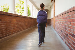 Girl walking in school corridor Stock Image