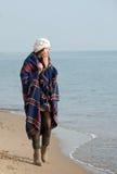 Girl walking the seaside Stock Photo