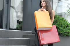 Girl walking with shopping bags stock photo