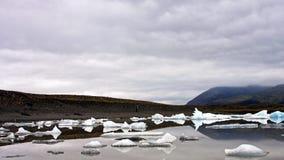 Girl walking on the shore of Jökulsárlón glacial lagoon Royalty Free Stock Photos