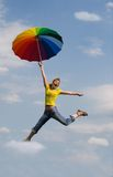 Girl walking in the sky stock photography