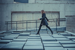 Girl walking on the slabs. Girl walking on the concrete slabs Royalty Free Stock Photo