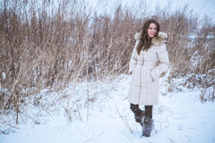 Girl walking in snow. Happy girl walking in snow Stock Image