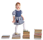 Girl  walking from stairs of book piles Royalty Free Stock Photography