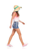 Girl Walking In Straw Hat Royalty Free Stock Photos
