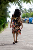 A girl Walking in street Stock Photography