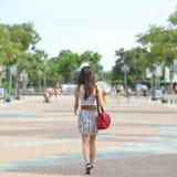 Girl walking on street Royalty Free Stock Photography