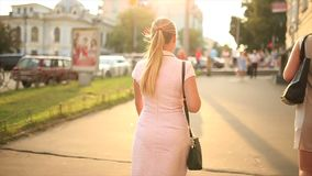 Girl walking on street. Beautiful girl walking on street stock footage