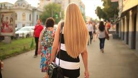 Girl walking on street. Beautiful girl walking on street stock video