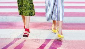 Girl walking on a street with colorful pedestrian crossing close. Girl walking on the street close up Royalty Free Stock Photo