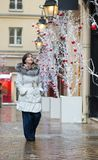 Girl walking on a street decorated for Christmas Stock Photo