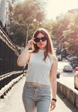 Girl walking in sunglasses Stock Photo