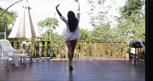 Girl Walking To Terrace Back Rear View, Stretch Arms Looking At Tropical Garden. Slow Motion 60 stock video