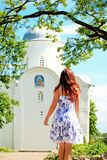 Girl walking towards an orthodox church Stock Photos