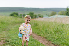 Girl Walking with Toy Royalty Free Stock Images