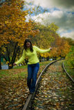 Girl walking on train tracks Royalty Free Stock Images
