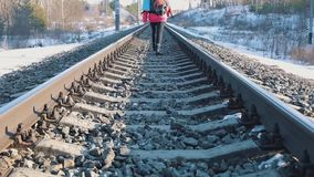 Girl walking on train tracks stock video