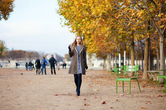 Girl walking in the Tuilleries garden Stock Photos