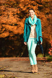 Girl walking with umbrella in autumnal park Royalty Free Stock Images