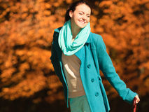 Girl walking with umbrella in autumnal park Stock Photo